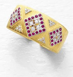 BUCCELLATI A Ruby, Diamond and Gold Bracelet The textured 18K gold hinged cuff, of pierced openwork design, decorated with circular-cut ruby and diamond navette-shaped panels, enhanced by circular-cut diamond clusters, diameter 5.5 cm. Signed 'M. Buccellati'