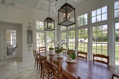 now that's a light filled kitchen.  reminds me of the eating area in wedding crashers