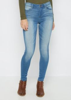 Keeping it casual has never been easier with this stylish jegging, fashioned with a heavy vintage wash in medium blue. Standard waist construction. Super fitted through leg.