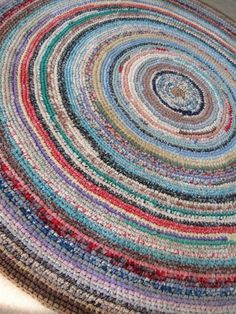 An antique crochet rag rug. You can tell that the maker used whatever she had as scrap. This was not a weekend project. This is the beauty of utility.