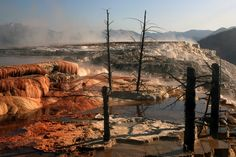 Mammoth Hot Springs has been shaped over thousands of years as hot water from the spring cooled and deposited calcium carbonate. Its energy has been attributed to the same system that fuels other Yellowstone geothermal areas. Yellowstone Nationalpark, Yellowstone Park, Wyoming, Spring Pictures, Natural Phenomena, Natural Wonders, Hot Springs, How To Take Photos, Beautiful Places