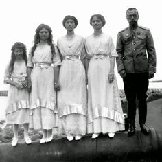 Tsar Nicolas II and his daughters on a cannon, c.1910s. From left to right, Anastasia Nicolaïevna Romanov, Maria Nicolaïevna Romanov, Tatiana Nicolaïevna Romanov and Olga Nicolaïevna Romanov near their father, Nicolas II Romanov, tsar of all Russias, a good father, proud of his daughters. A moment of happiness during a family holidays on the Black Sea, probably in Crimea.