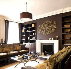 Chocolate brown with deep gold metallics bring a nice warm ambiance to a living room. | Decorators Best