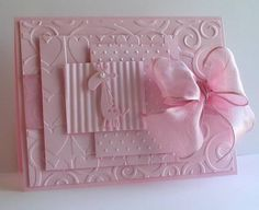 handmade card ... monochromatic ... delightful layers of embossed pink paper with a full organza bow and a small die cut animal ...