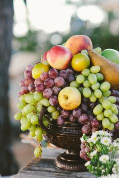 #Fruit Centerpieces | See the wedding on SMP - http://www.StyleMePretty.com/2014/01/10/malibu-wedding-at-rancho-del-cielo/ Laura Goldenberger Photography