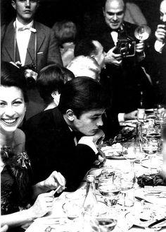 Alain Delon, alone among others, 1962