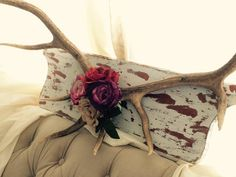These authentic deer antlers are the perfect compromise of country and chic. Whether you are a hunting family or love a touch of rustic these are it. These large antler are mounted to solid wood, adorned with four large high quality faux roses, and ready to hang with sturdy wire. Definite statement piece to any home or shop. Dimensions: Wood Mount 33.5in x 9.5in Antlers 44.5in x 15in