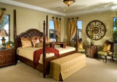 tuscan inspired bedroom with poster bed