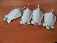 These are adorable!!!  Little paper mice with a sucker tucked inside for the tail!  These would make sweet little favors at a party or for a classroom treat.