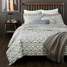 """Tangier Duvet Cover   The modern Moroccan-inspired design of the Tangier collection brings a fashion-forward look straight from the catwalk to the bedroom. Incorporating a design technique traditionally used in apparel, the """"clip dot"""" method creates a fringe embellishment to add texture, and dimension to the top-of-bed."""