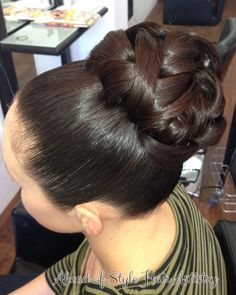 Sleek high curled bun, timeless bridal style. Hair styled by Chanae Hiller at Ahead of Style Hair Artistry.