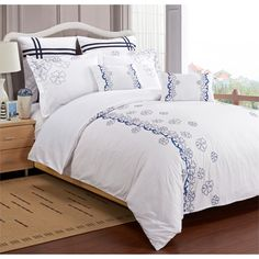 Bring simple beauty to any guest bedroom with this seven-piece duvet cover set. Featuring a charming blue hibiscus design on a field of white, this bedding set is soft and luxurious. The duvet cover and shams are machine washable for easy cleaning.