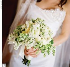 Suzanna carried white peonies, lilac, gardenias, ranunculus, and champagne roses tied with