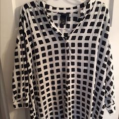 Lane Bryant black/white square high low top. Lane Bryant high low black/white square top. Worn once, in perfect condition!! Size 18/20 Lane Bryant Tops Blouses
