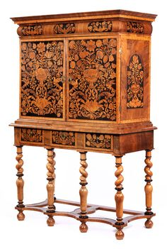 Rare, very fine inlayed cabinet Height: 165.5 cm.  Width: 111.5 cm.  Depth: 50 cm.  England, ca. 1720.   Softwood and oak structure, with walnut and fruitwood marquetry, partially stained green and red as well as woods with pyrography shadowing. Brass strips and brass lock. With key. Restored, damaged and exterior of the veneer slightly cracked, with small repairs.