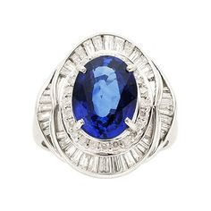 Sapphire, Diamond, Platinum Ring The ring features an oval-shaped sapphire measuring 11.55 x 8.71 x 5.44 mm and weighing approximately 5.00 carats, enhanced by tapered baguette and full-cut diamonds weighing a total of 1.20 carats, set in platinum
