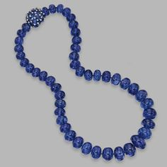 18 KARAT WHITE GOLD, TANZANITE BEAD, SAPPHIRE AND DIAMOND NECKLACE, MICHELE DELLA VALLE The graduated single-strand composed of tanzanite beads weighing 834.80 carats, the clasp set with oval sapphires weighing 16.83 carats, and small round diamonds weighing .49 carat