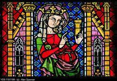A 14th century stained glass window depicting Saint Barbara, Freiburg Münster, Baden Wurtemburg, Germany, Glass is circa 1320-1340.