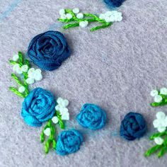 This sweet little silk ribbon rose heart will end up in a navy frame.