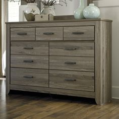 "Signature Design by Ashley Zelen 7 Drawer Dresser.  $430 on sale (27% off).  Overall: 42.78"" H x 61.26"" W x 15.91"" D"