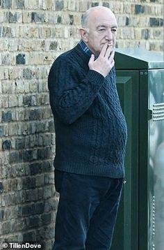 Wearing a sensible navy jumper, the balding man grinding out a cigarette butt on a South London street could hardly cut a more humdrum figure. This is John Deacon, the 'lost' member of Queen. Freddie Mercury Last Photo, Queen Freddie Mercury, Roger Taylor, Queen Photos, We Will Rock You, Bald Men, Queen Band, John Deacon, Killer Queen