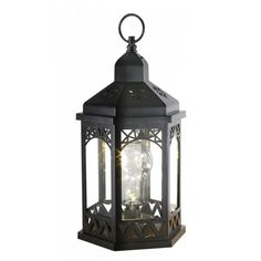 What a lovely new take on the traditional lantern. This black lantern with decorative triangle cutouts features a beautiful light bulb with shimmering lights.
