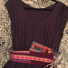 Anthropologie top with cute belt! Awesome top. Used condition but still very good. The belt on this shirt is fantastic. Anthropologie Tops Tees - Short Sleeve