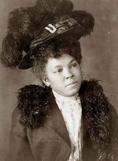 This picture was taken in 1899 and shows a young black woman. The woman is dressed in nice clothes which was somewhat uncharacteristic of African Americans at this period in time. She appears more affluent than what was typical.