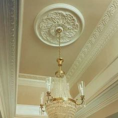 Popular in middle- to upper-class homes in the century, ceiling medallions were designed to add architectural interest and beauty to a room. They were typically placed above a chandelier so that the light would emphasize their delicate patterns. Victorian Interiors, Modern Victorian, Victorian Decor, Victorian Homes, Ceiling Rose, Ceiling Trim, Ceiling Detail, Interior Decorating, Interior Design