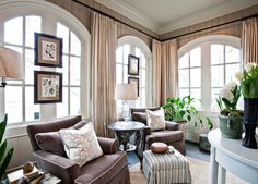 Great arched windows with artwork.