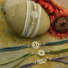 Layered Chakras, leather wrap bracelet with deer hide leather cord and charms. Link has free video and materials list - At Nina Designs.