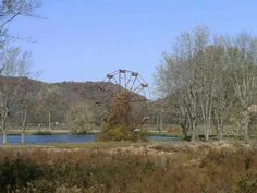 he abandoned Ferris wheel at the site of a dilapidated amusement park along the shore of Lake Shawnee in West Virginia. The park is believed to be one of the most haunted places in West Virginia Lake Shawnee Amusement Park, Abandoned Amusement Parks, Most Haunted Places, Spooky Places, Abandoned Buildings, Abandoned Places, Virginia Occidental, Ghost Hunting, West Virginia