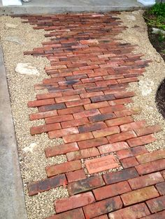 old bricks, pea gravel and rocks - this pathway design is both eye-catching and unique.  A curb-appeal winner!