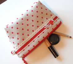 Handmade red polka dot large beauty bag, embellished with vintage buttons, striped ribbon, lace and pearls.    Ideal for all your beauty essential