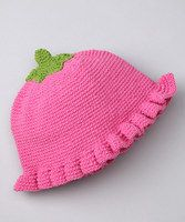 You can get away with quite a few things when you're little, like wearing a pink posy on your head. This hand-crocheted hat is pretty in pink and goes the extra mile when it comes to darling details. From the teeny stem to the ruffled hem, this sweet piece will refresh her winter wardrobe with color and uniqueness.100% cottonMachine wash