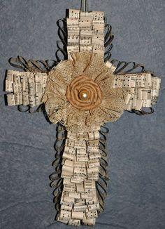 Cross made from old hymnal pages