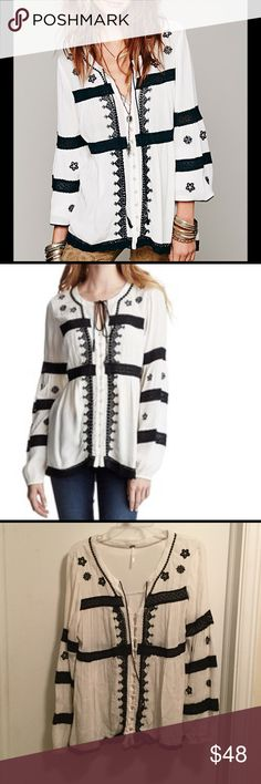 Free People Iris Boho Top Free People Iris Boho top in size small. Classy black and white with lace and embroidered detail throughout, silver threading, and button front. Elastic sleeves can be worn up or down (as stock pics show). Beautiful top I just don't wear it enough! Excellent used condition. Free People Tops Blouses