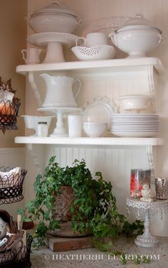 white dishes open shelves