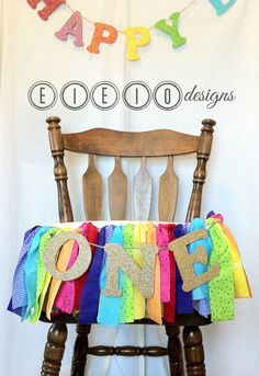 Rainbow birthday?! So cute! I love all of the colors in this one...and the light blue has sparkle tulle! So much color and texture and then of course...gold glitter letters. Perfection. Found it on Etsy: EIEIOdesigns