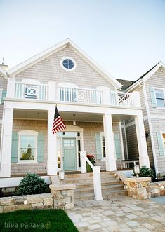 teal doors & shutters with white trim and cedar shake siding ....LOVE