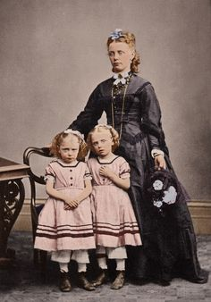 Victorian mother and twin daughters.
