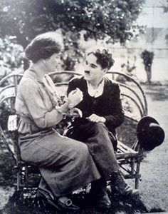 Helen Keller teaching Charlie Chaplin the manual alphabet ~ 1919