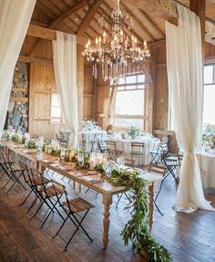 For those who prefer to have their favorite rustic wedding outside, a barn wedding could be the perfect solution. Barn wedding theme is becoming more and more popular as it not only saves so much c… Rustic Wedding Reception, Wedding Reception Centerpieces, Reception Ideas, Wedding Receptions, Wedding Barns, Rustic Barn Weddings, Tulle Wedding Decorations, Wedding Ceremony, Wedding Draping