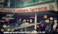 A sneaky snap from behind the drumkit. Ready to play with an ensemble in St. Stephens shopping centre.  Www.acousticguitarplayer.co.uk