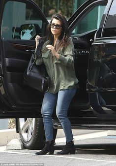Working mom: While Kourtney Kardashian, 35, is juggling new motherhood, work and the care of three children, Scott is attempting to overcome his demons at a luxury retreat in Costa Rica