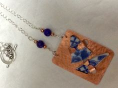 Textured copper, ceramic, howlite and plated metal necklace.