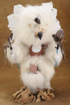 Fully feathered & furred, this doll is an amazing & irreplaceable example of #Native #American creativity & craftsmanship. This #handmade #Owl #Kachina #Doll has been captured in mid-step as he dances to bring snow & cold weather essential to the growth of crops. He also warns the tribe to conserve their energy until the time is right, Spring! The clay painted dancer is a commanding figure with a magnificent rabbit fur head topped off by hand cut feathers. $250.00 #Alltribes Native American Artists, American Indians, Clay Paint, Rabbit Fur, Cold Weather, Statues, Nativity, Feathers, Hand Carved
