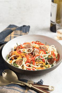 Sausage and Peppers with Zucchini Noodles - delicious - I tweaked by only spiralizing the zucchini. Sliced the peppers and onions normally, and topped with grated parm
