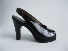 Classic, gorgeous black patent sling backs from the 40s.
