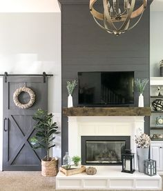 Three Easy Steps to a Fixer-Upper Worthy Fireplace Want to turn your boring, dated fireplace into a Chip & Joanna would be proud focal point? DIY tutorial featuring plans for a mantel, hearth and surround. Farmhouse Fireplace Mantels, Fireplace Redo, White Fireplace, Bedroom Fireplace, Fireplace Remodel, Living Room With Fireplace, Fireplace Design, Fireplace Ideas, Fireplace Modern